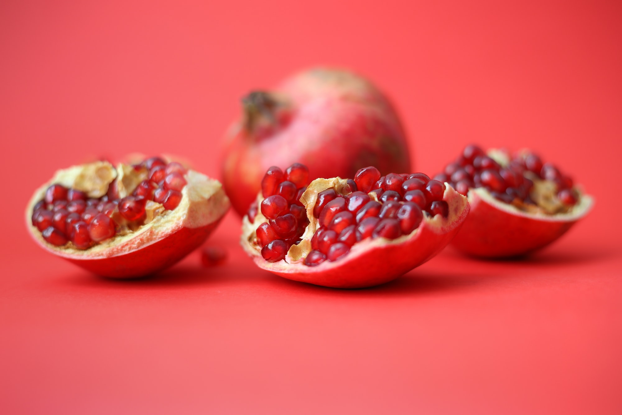 Pomegranate is a healthy fruit with a mythical past by Sahand Babali for Unsplash.
