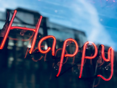 red love neon light signage happiness teams background
