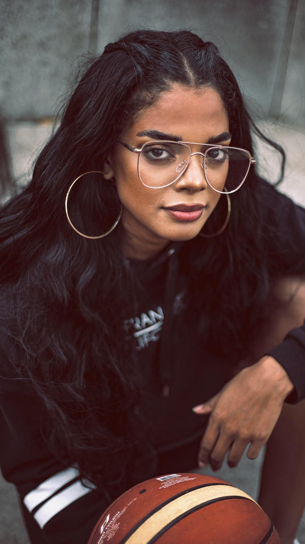 woman in black crew neck t-shirt wearing eyeglasses