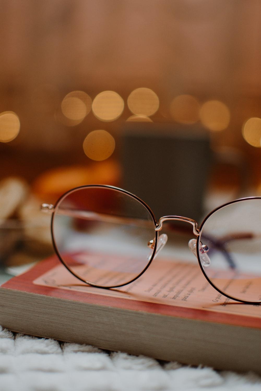 silver framed eyeglasses on book page