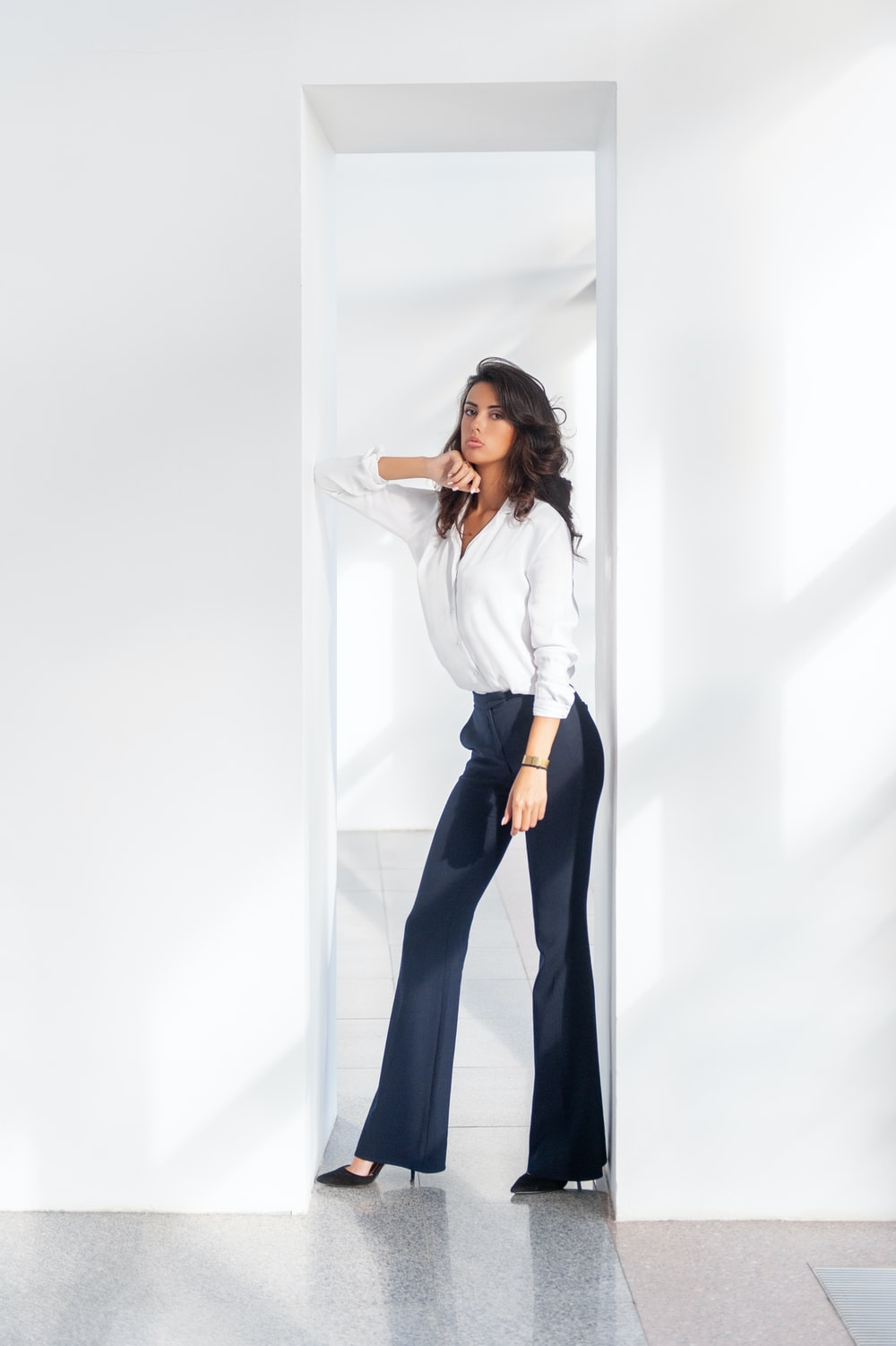 woman in white long sleeve shirt and blue pants