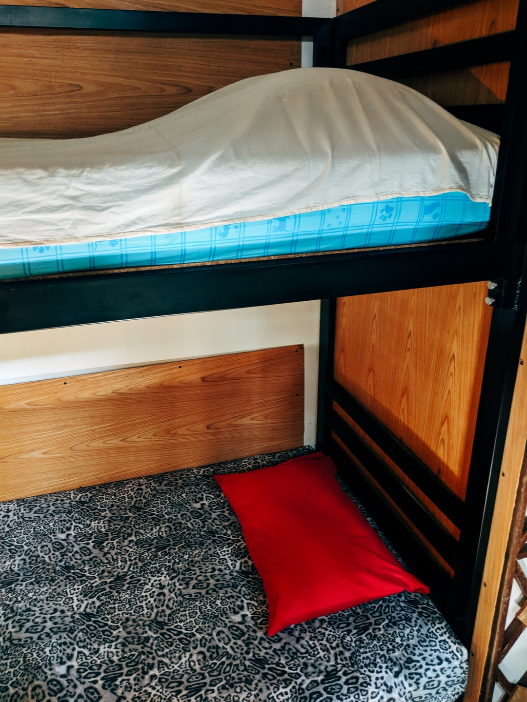 Bunk bed with pillows in a hostel