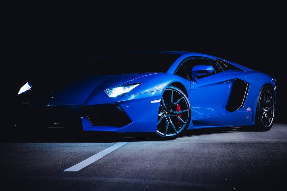 blue ferrari 458 italia on black background