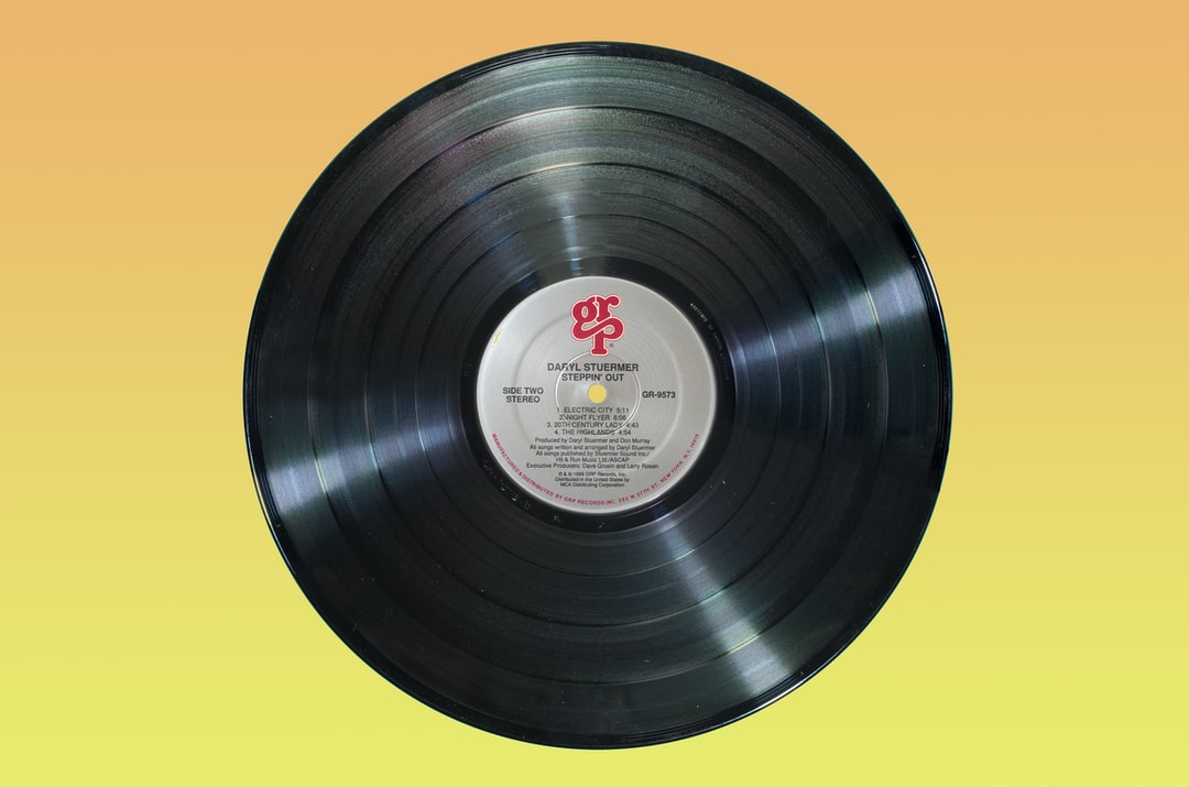Long play record on yellow background