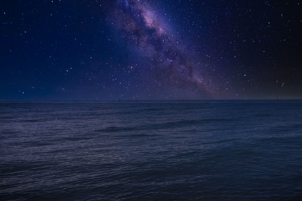 body of water under starry night