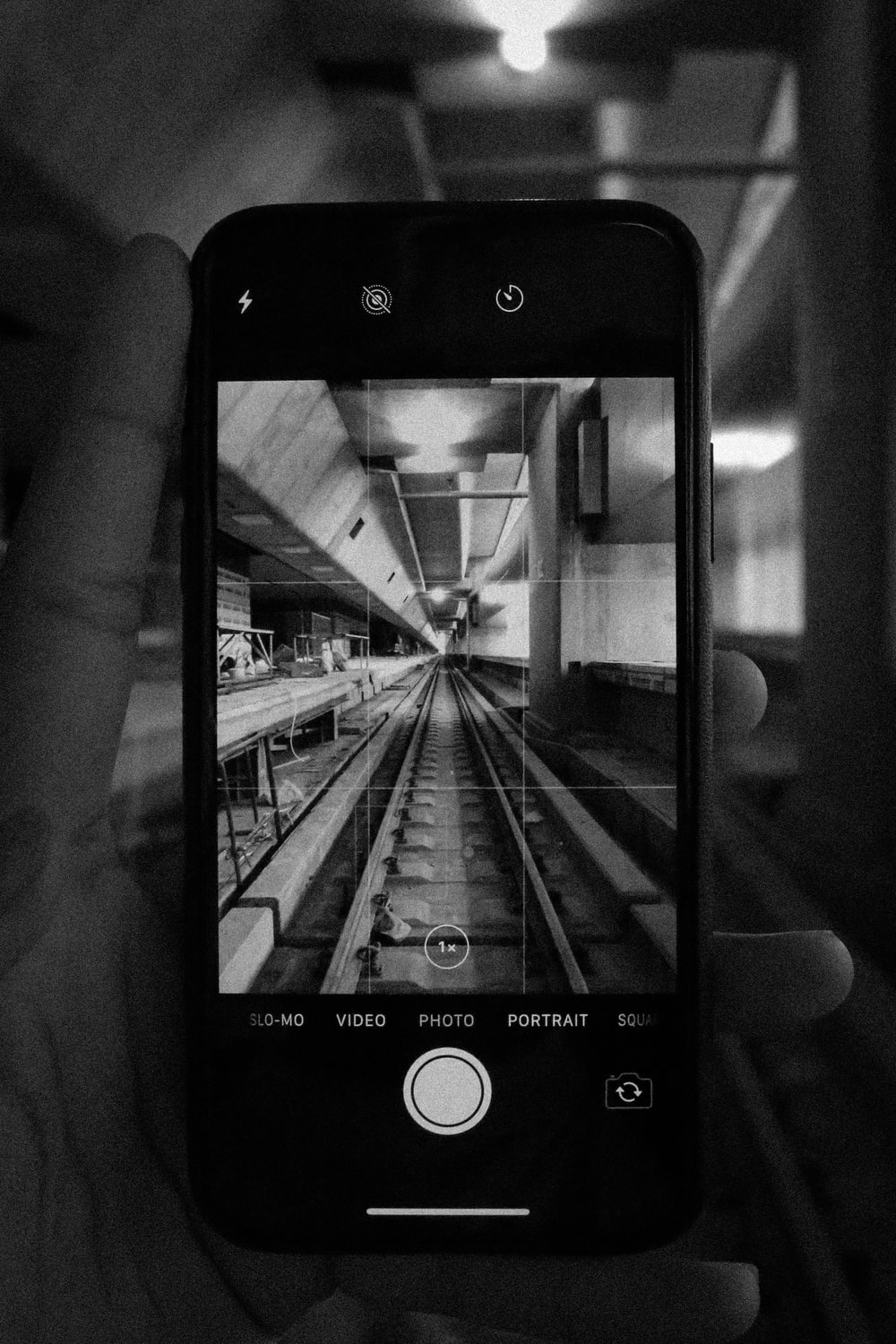 person holding iphone displaying camera