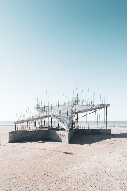 gray wooden bridge on sea during daytime