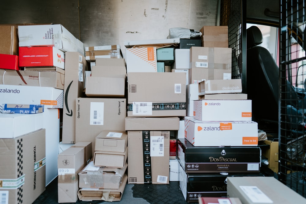 brown cardboard boxes on black plastic crate