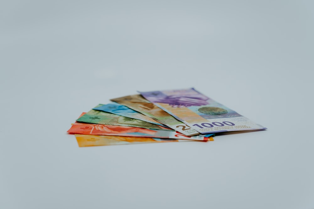 stack of banknotes on white surface