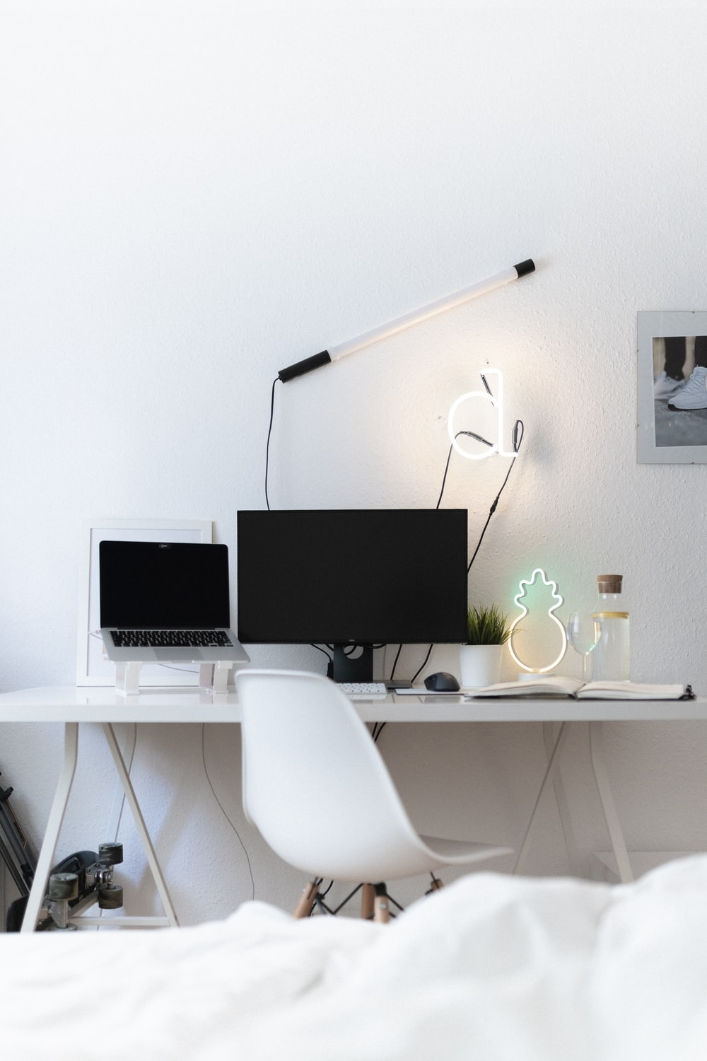 black flat screen computer monitor on white table
