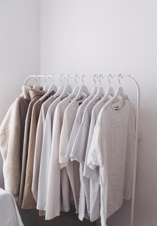 white long sleeve shirt on white clothes hanger