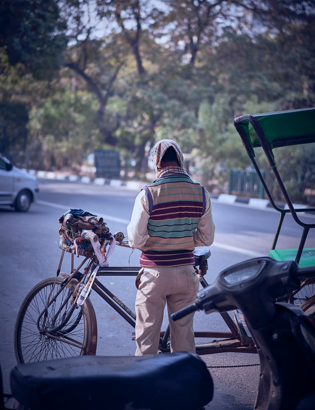 A Rickshaw driver counting his collected fare