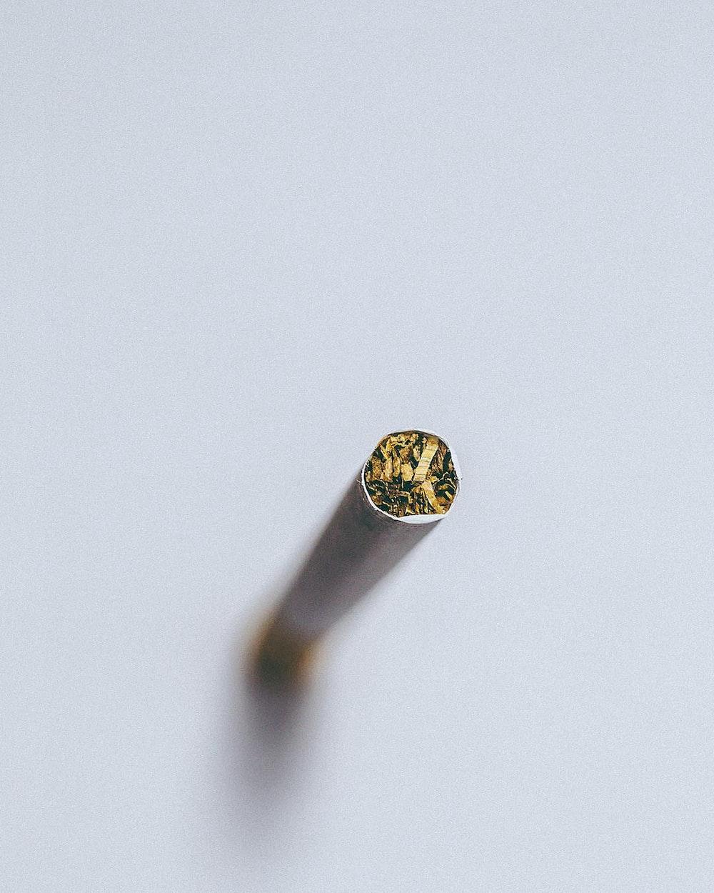 silver diamond ring on white surface