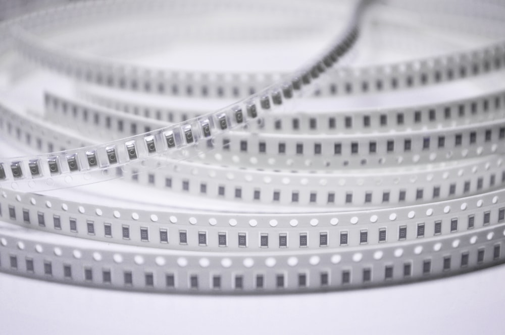 white coated wire on white surface