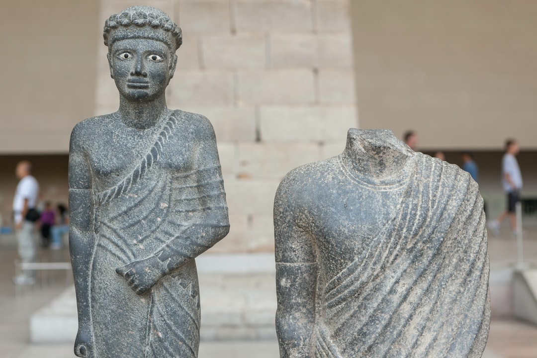Official with Pleated Costume (150–1 BC) Striding draped figures appear in the Egyptian statuary repertoire in the mid-second century B.C.; such statues seem often to have stood in front of temples pylons. Possibly the diadem worn by this figure indicates a priestly office.