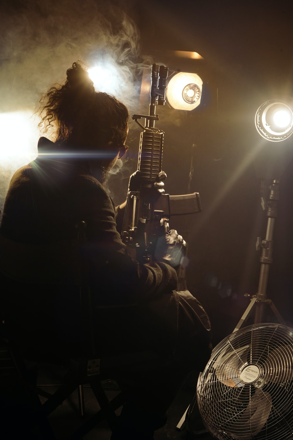 silhouette of 2 men standing in front of microphone