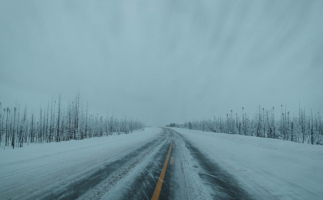 Black Asphalt Road Covered With Snow - unsplash
