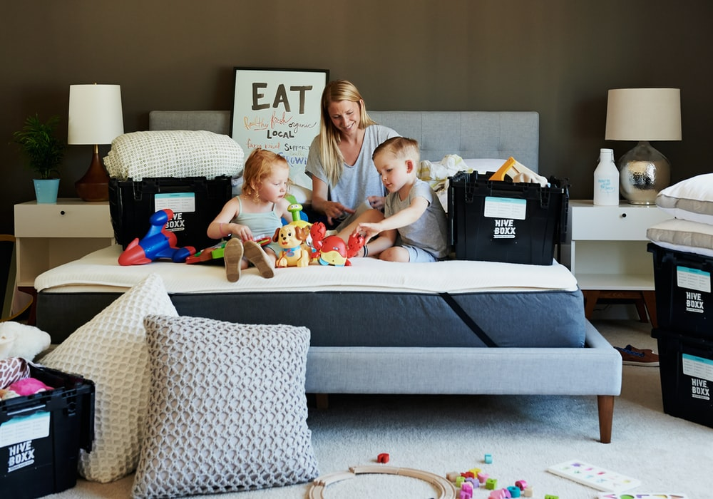 3 children sitting on gray couch