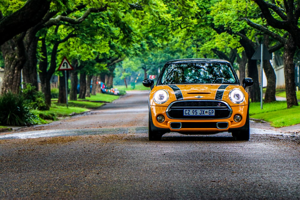 yellow and black mini cooper on road during daytime