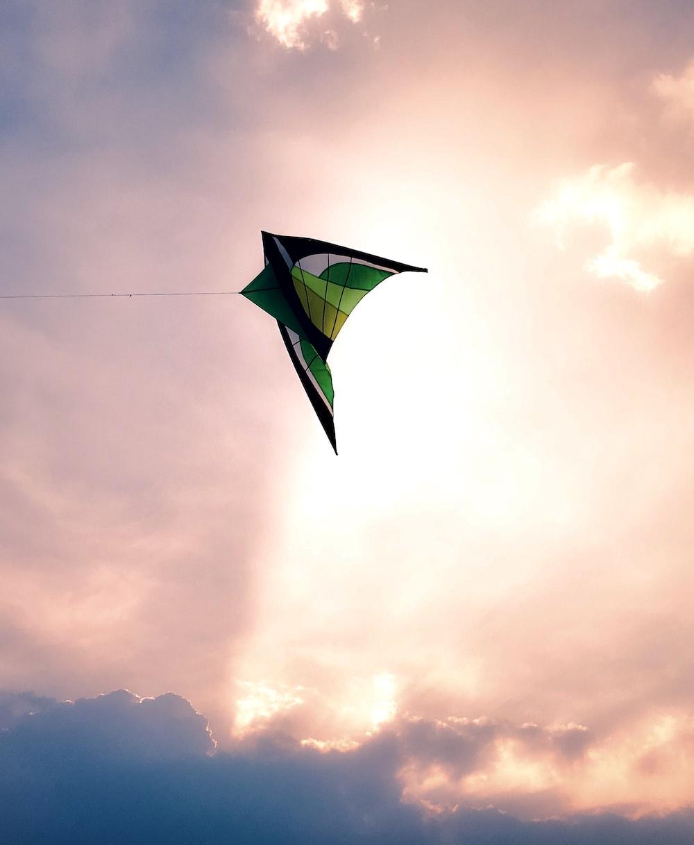 green umbrella on top of mountain