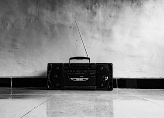 black radio on white floor tiles