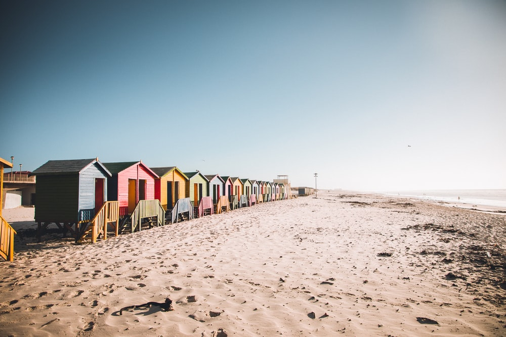 houses on beach during daytime