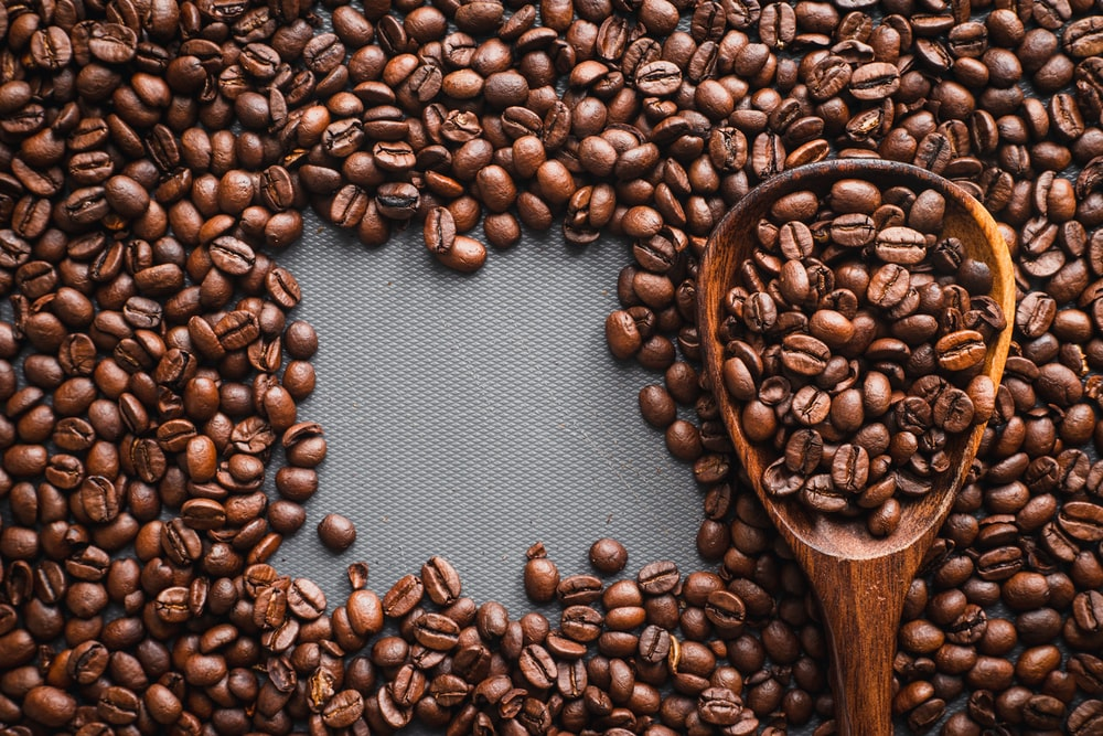 brown wooden spoon with coffee beans