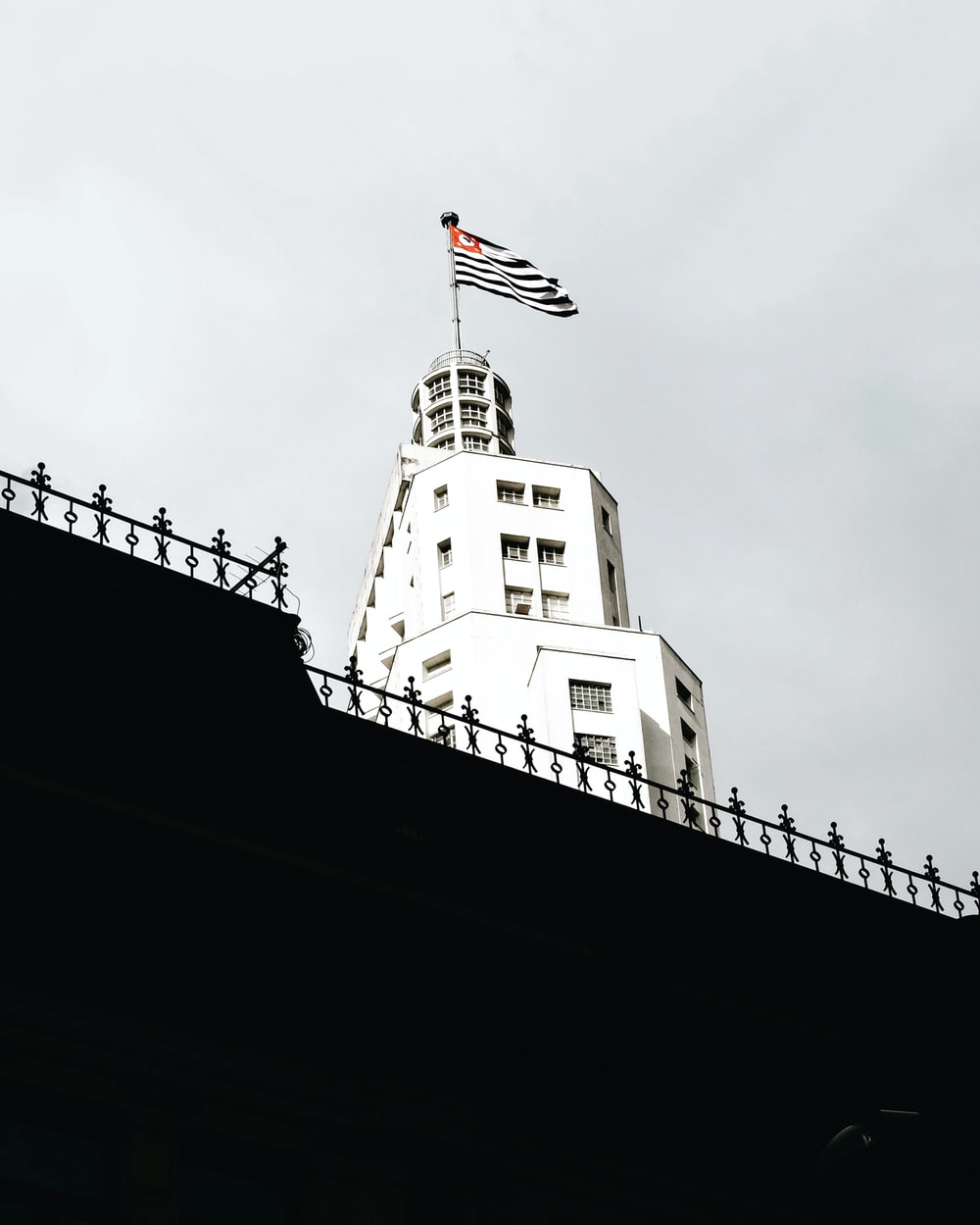 us a flag on top of white building