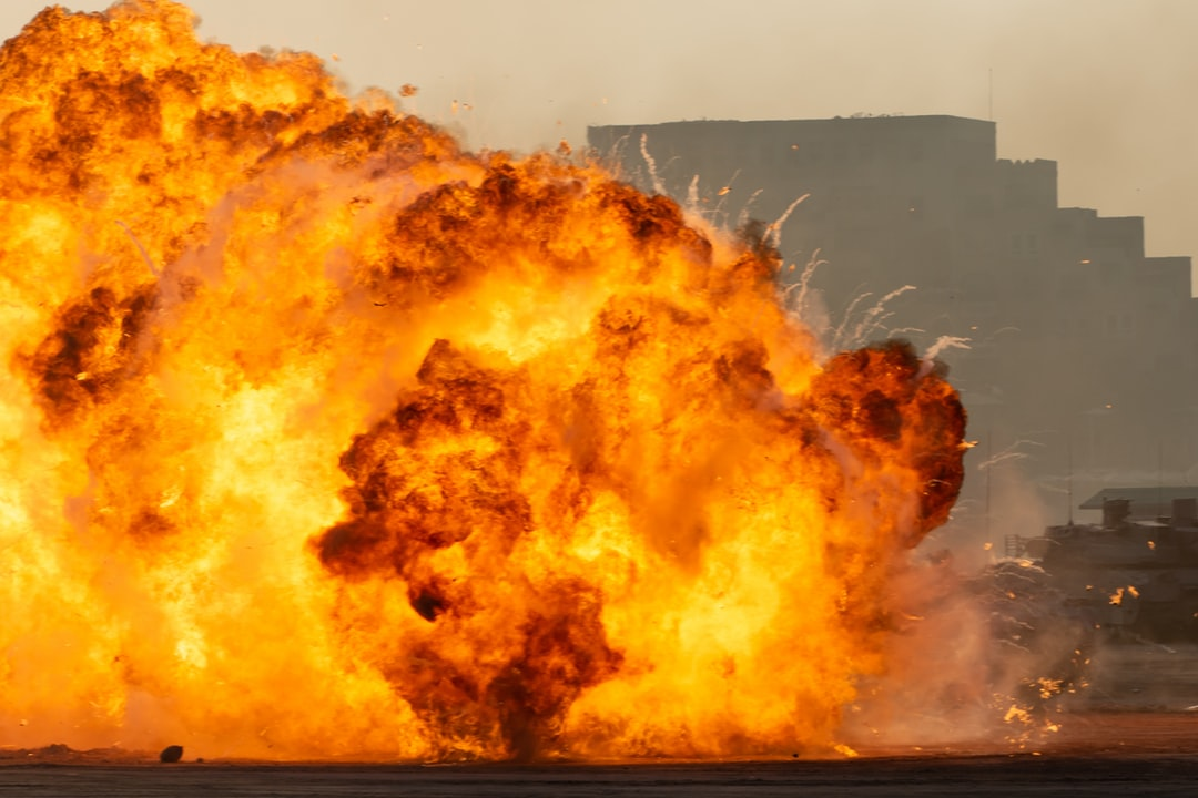 Massive fire explosion close up in military combat and war. Vehicle explosion from a tank in a city in the Middle East. Military Concept. Strength, power, explosion.