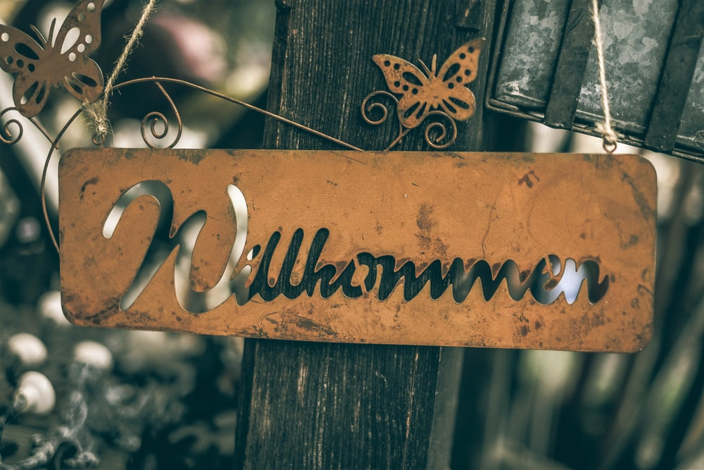 brown wooden fence with love text