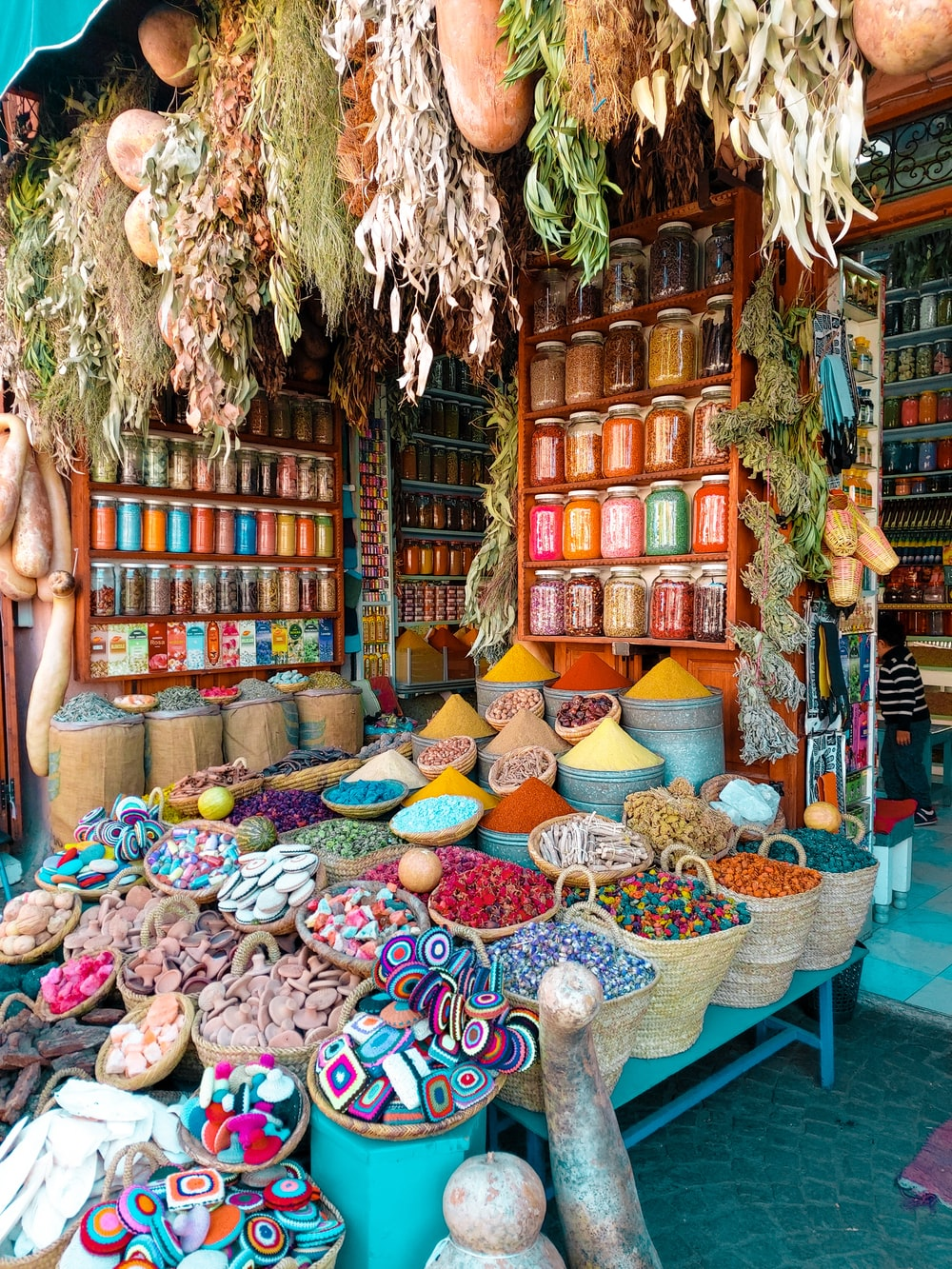 assorted color of wicker baskets on display