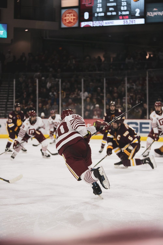 ice hockey players on ice hockey stadium