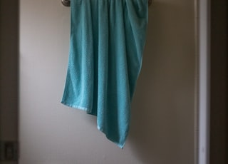 green towel on white wall