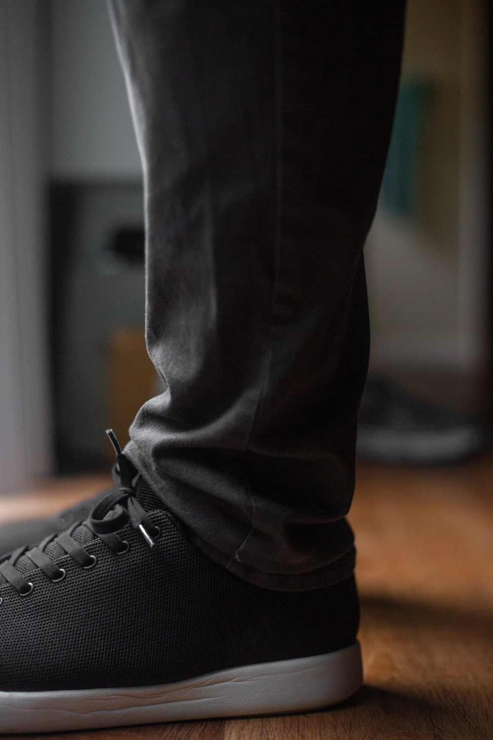 person wearing black leather boot