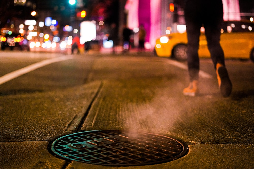 person walking on street during night time