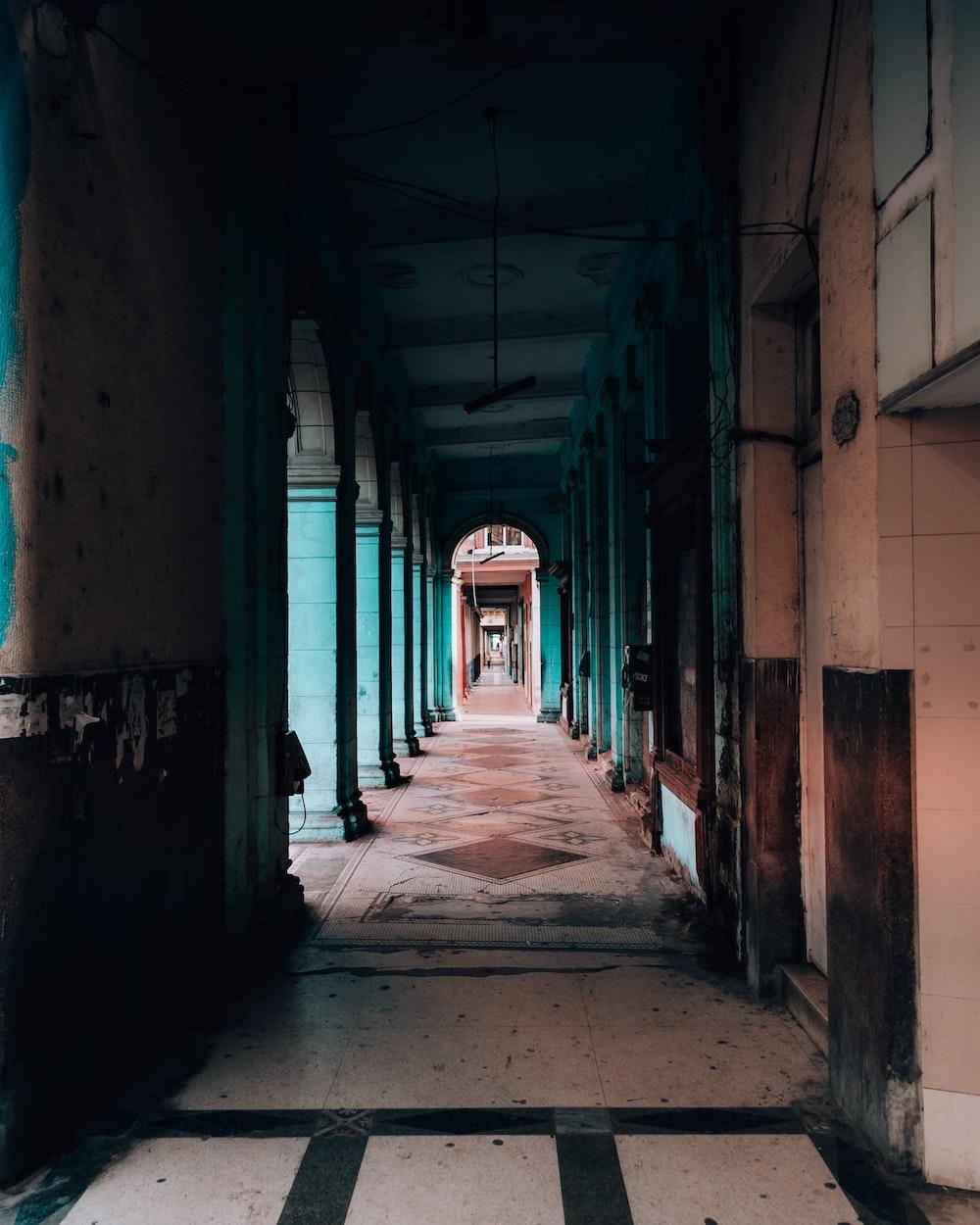 empty hallway with red columns