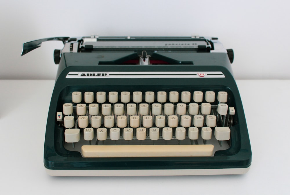 black and white typewriter on white table