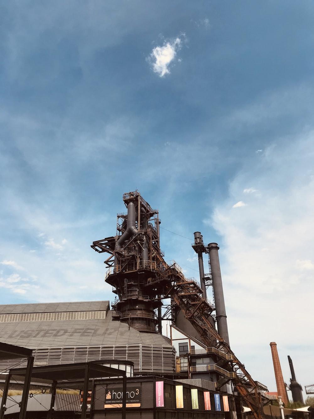 brown metal statue under blue sky during daytime