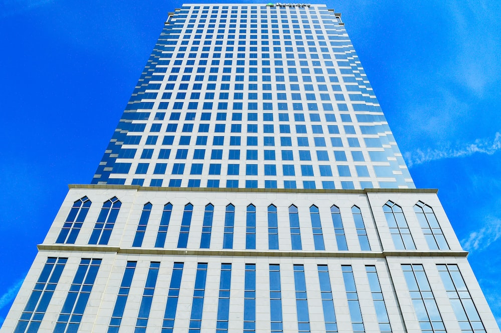 white and blue high rise building