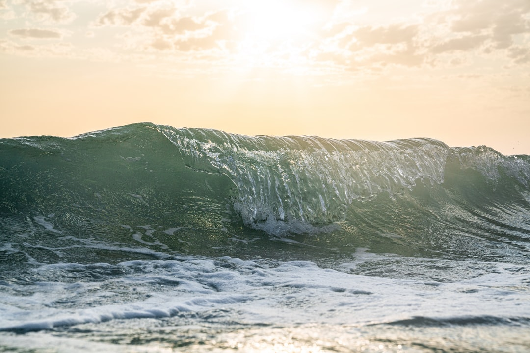 Frozen Wave At Sunrise. Light Bright Wave. Sun On the Horizon. - unsplash