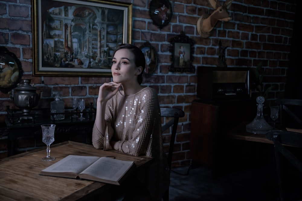 woman in white and black long sleeve shirt sitting on chair