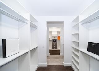 white wooden cabinet on brown wooden parquet floor