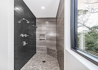brown tiled room with brown tiled walls