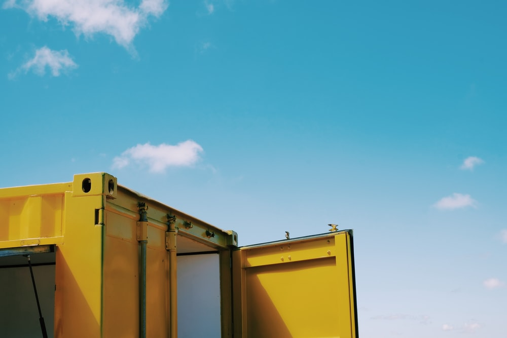 yellow and white building under blue sky during daytime