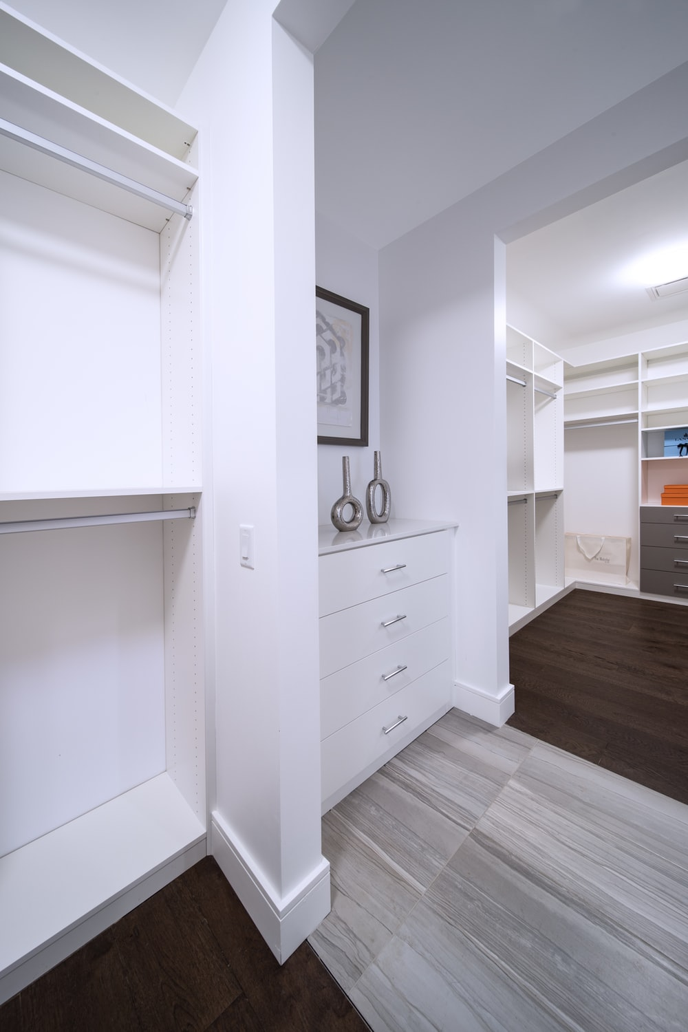 white wooden drawer beside white wall