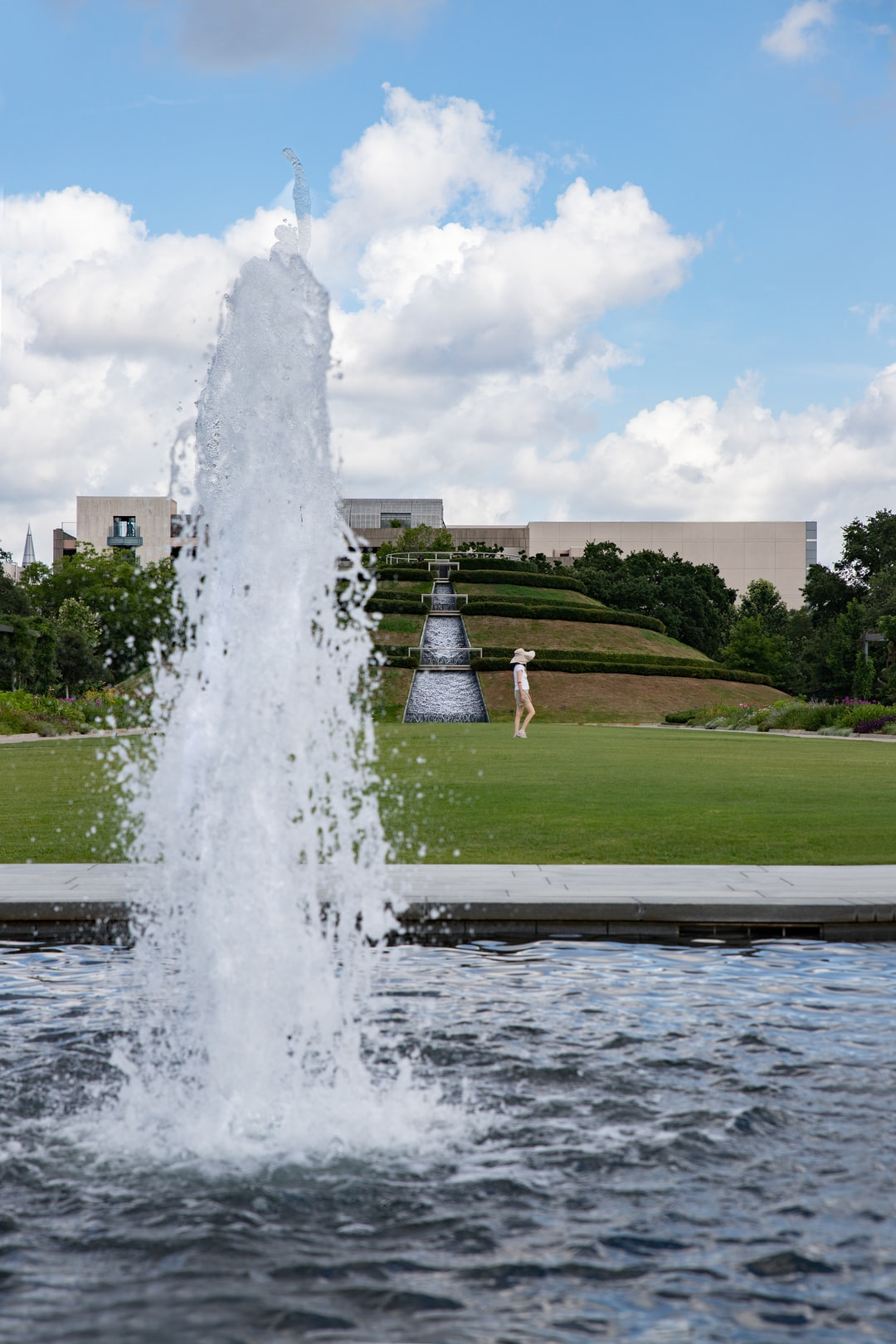 Outside Water fountain with green grass field