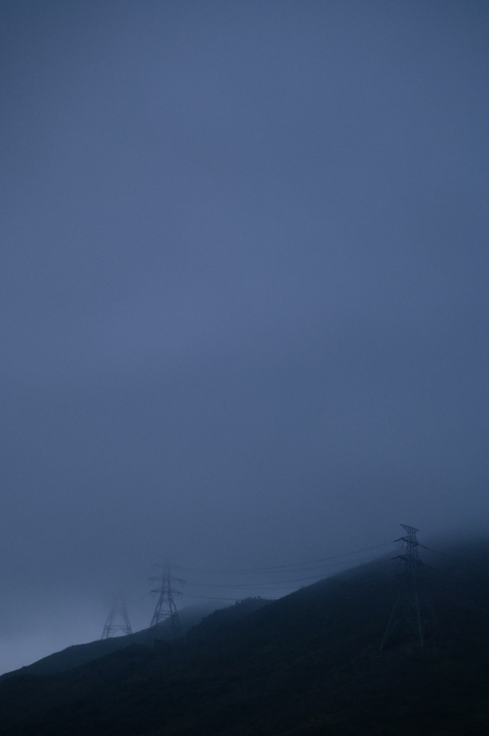 silhouette of mountain under gray sky