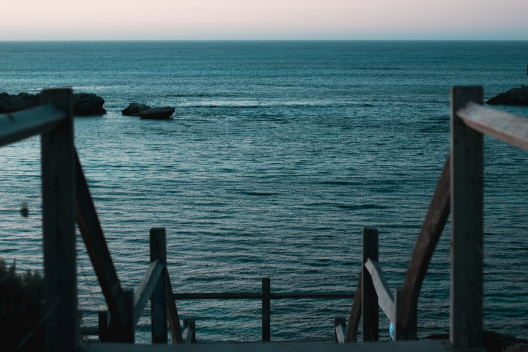 Brown Wooden Dock On Blue Sea During Daytime - unsplash