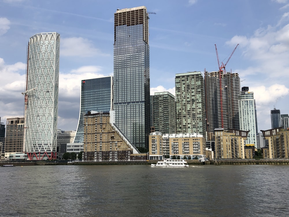 high rise building near body of water during daytime