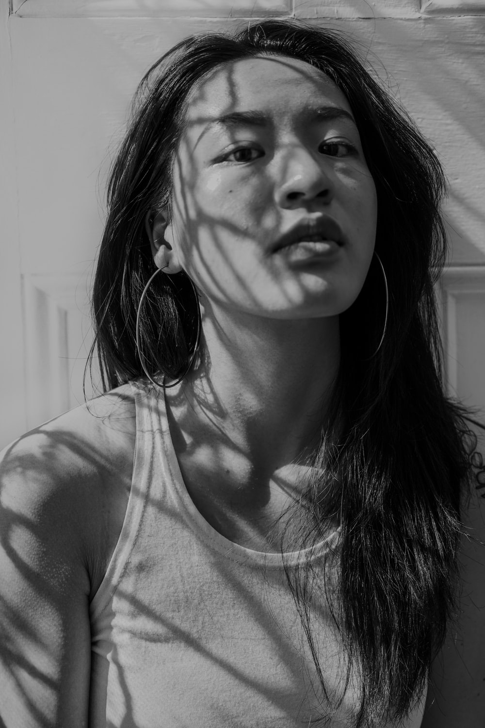 woman in tank top in grayscale photography